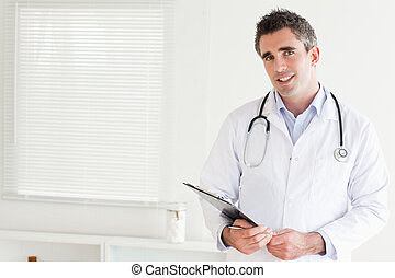 Smiling male Doctor looking into the camera