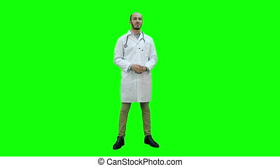 Smiling male doctor talking to the camera on a Green Screen, Chroma Key.