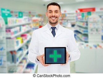 smiling male doctor with tablet pc at drugstore - medicine, ...