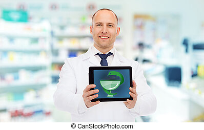 smiling male doctor with tablet pc at drugstore
