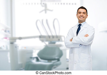 smiling male middle aged dentist - healthcare, profession,...