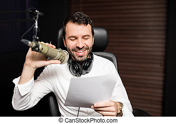 Smiling male radio host moderating