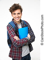 Smiling male student standing with folders over gray background