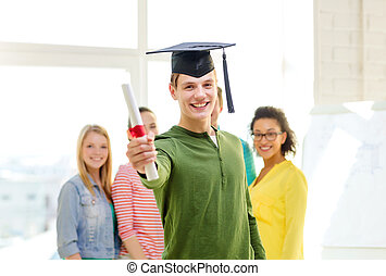 smiling male student with diploma and corner-cap