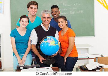 male teacher holding a globe