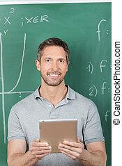 Smiling Male Teacher Holding Digital Tablet - Portrait of...