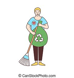 Smiling male volunteer with broom and recycling bag sweeping...