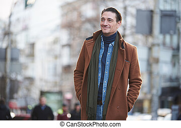 Smiling male walking on street