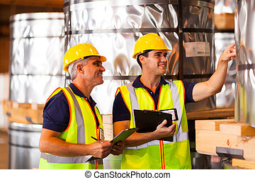 warehouse workers counting stock - smiling male warehouse ...