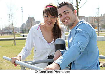 Smiling man and woman relaxing outdoors