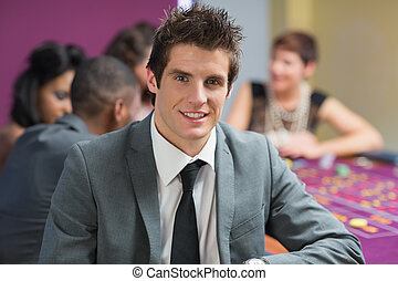 Smiling man at roulette table