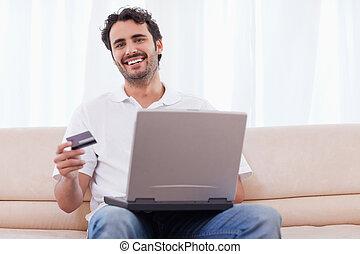 Smiling man buying online