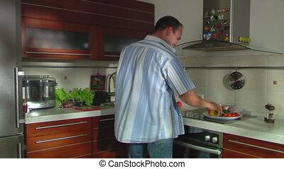 smiling man cooks