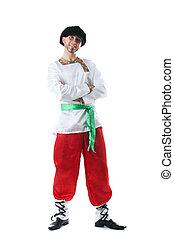 Smiling man dressed as peasant posing at camera