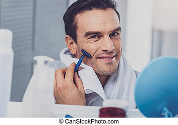 Smiling man feeling relaxed after taking shower