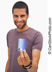 Smiling man holding credit card