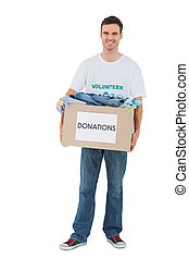 Smiling man holding donation box