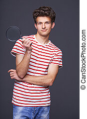 Smiling man holding magnifying glass