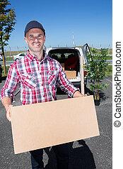 Smiling man holding parcel