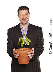 man holding pot with a tree