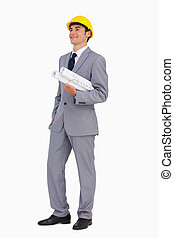 Smiling man in a suit with safety helmet and plans