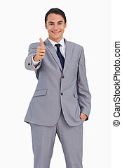 Smiling man in suit the thumb-up