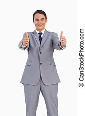 Smiling man in suit the thumbs-up