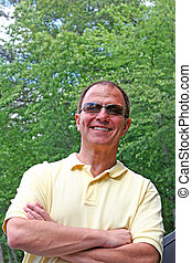 Smiling Man in Sunglasses