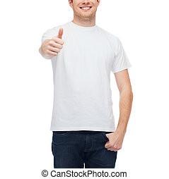 smiling man in white t-shirt showing thumbs up
