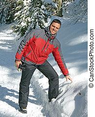 smiling man in winter landscape