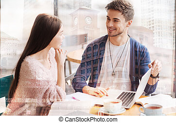 Smiling man looking at beautiful girl