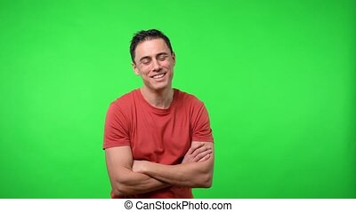 Smiling man looking at camera. Chroma green background.