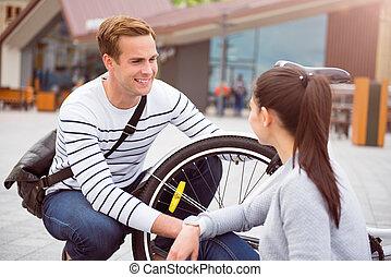 Smiling man looking at woman