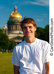 smiling man with Isaac's Cathedral on background