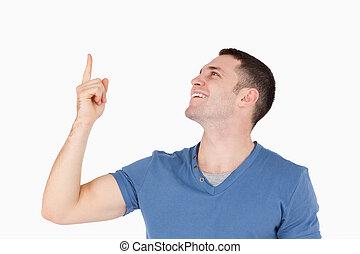 Smiling man pointing at something