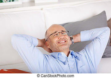 Smiling man relaxing at home