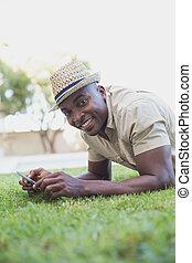 Smiling man relaxing in his garden