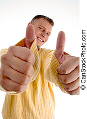 smiling man showing  thumbs up with both hands
