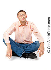 Smiling man sitting in the lotus position