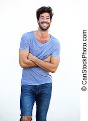 Smiling man standing with arms crossed isolated on white