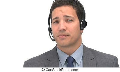 Smiling man talking with headphones against a white...