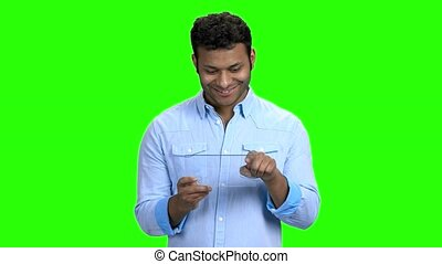 Smiling man using glass digital device. Handsome guy using...