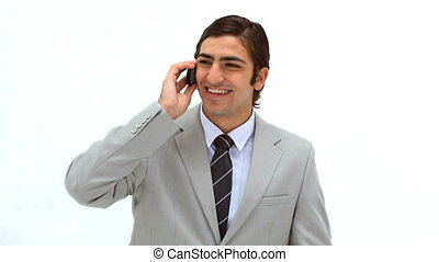 Smiling man using his mobile phone