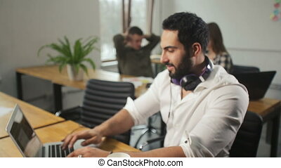 Smiling Man Using Laptop - Smiling handsome man with neat...