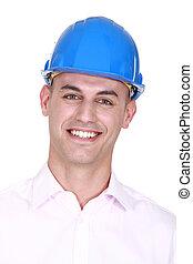 Smiling man wearing a hardhat