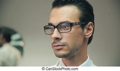 Smiling man wearing eyeglass - Closeup of smiling man...
