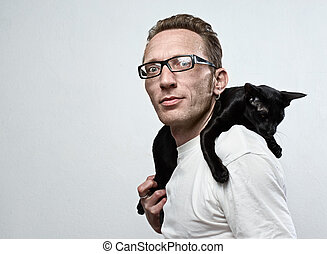 smiling man with a cat on his shoulders