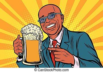 Smiling man with a mug of beer foam. African American people