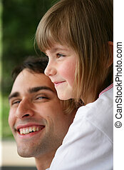 Smiling man with cute little girl
