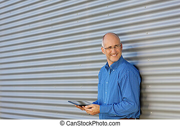 Smiling Man With Digital Tablet